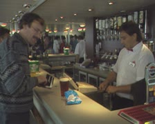 Man buying pint of beer at bar Stock Footage