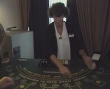 Blackjack dealer dealing cards Stock Footage