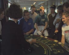 People at a blackjack table preparing to play cards Stock Footage