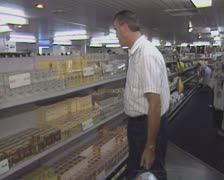 Man shopping in convenience store Stock Footage