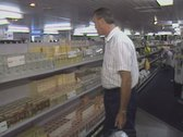 Stock Video Footage of Man shopping in convenience store