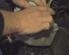 Putting cap on and off oil tank in engine Stock Footage