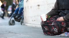 Woman homeless in city begging - stock footage