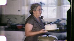 Middle Aged Woman in the Kitchen Cake Fat Food 1960s Vintage Film Home Movie 976 Stock Footage