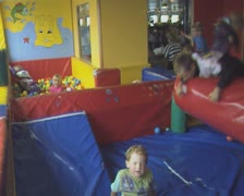Children playing in indoor play area Stock Footage