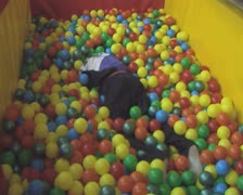 Children playing in ball pit Stock Footage