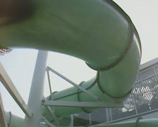View of someone sliding down waterpark swimming chute from outside Stock Footage
