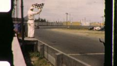 Car at Finish Line Flag Winner Racetrack 1940s Vintage Film Home Movie 988 Stock Footage
