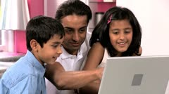 Young Asian Father & Children Using Laptop in Kitchen Stock Footage