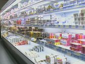 Stock Video Footage of Travelling shot inside convenience store moving past dairy section