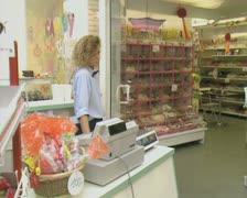 Checkout woman standing in shop Stock Footage