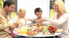Young Family Eating Healthy Meal Stock Footage