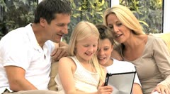 Caucasian Family Using Wireless Tablet for Online Video Chat - stock footage
