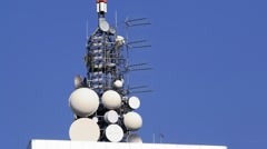 Microwave antennae on building top Stock Footage