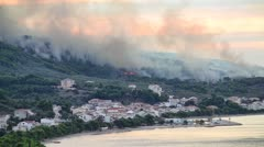 Burning fire near the city - stock footage