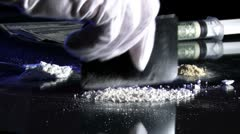 Cutting up drugs, cocaine - stock footage