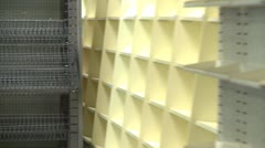 Bankrupt video store #7, empty wire shelves, zoom Stock Footage