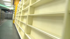 Bankrupt video store #5, empty wire shelves walk along Stock Footage