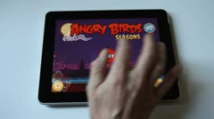 Starts and play Angry Bird on a Ipad Stock Footage