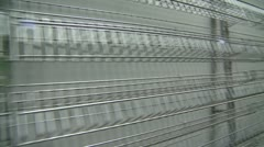 bankrupt video store #4, empty wire shelves walk along - stock footage
