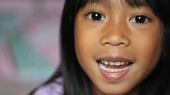 Little Girl Wiggling Her Loose Front Tooth Stock Footage