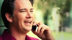 Smiling man talking on cellphone close up Stock Footage