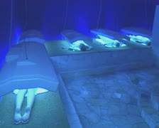 People lying under sunbeds Stock Footage