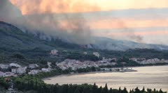 Fire over small city - stock footage