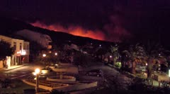 Fire near the city at night Stock Footage