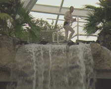View from top of waterfall to swimming pool below Stock Footage