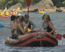 Close up of people in raft floating on river - stock footage