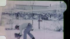 Man Snowball Throw Snowy Day with Pet Dog 1950s Vintage Film Home Movie 1014 Stock Footage