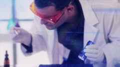 CSI looking for evidence with UV light lens flare - stock footage