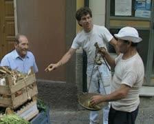 Seller weighing bananas Stock Footage
