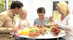 Young Family Enjoying a Healthy Meal Stock Footage