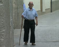 Old man walking down street with cane Stock Footage