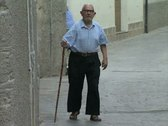 Stock Video Footage of Old man walking down street with cane