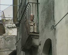Elderly woman sitting on balcony Stock Footage