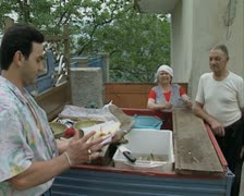 People buying fish at stall Stock Footage