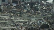 Japan Tsunami Aftermath - Survivors Walk Through Devastated Kesennuma City Stock Footage