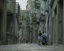 Ground level view of street and children Stock Footage