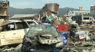 Japan Tsunami Aftermath - Cars Litter Street In Kesennuma City Stock Footage