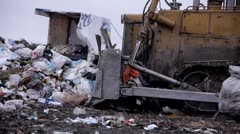 stock footage tractor raking up trash garbage dump - stock footage