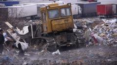 Stock video footage tractor raking up trash garbage dump Stock Footage
