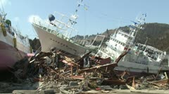 Japan Tsunami Aftermath - Ships Smashed And Washed Ashore - stock footage