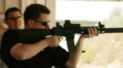 Shooting fully auto with a silencer Stock Footage