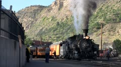 A steam train at the station. - stock footage