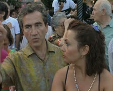 Couple standing and talking in crowd Stock Footage
