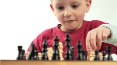 Little boy fascinated by the game of chess. Small genius. Stock Footage
