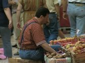 Stock Video Footage of Man sitting at fruit stall